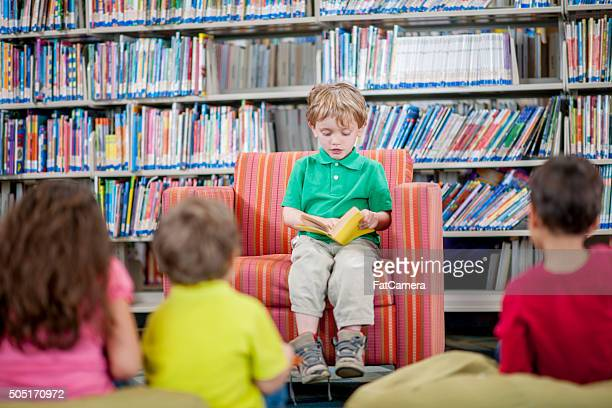 Little Boy Reading to His Peers