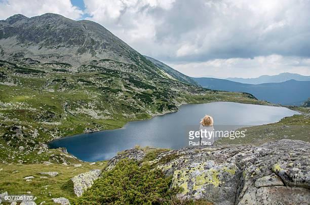 Little boy Relaxing Near  Bucura Lake, Retezat Mountains, Romania