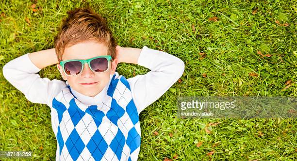 Little Boy Relaxing On Grass