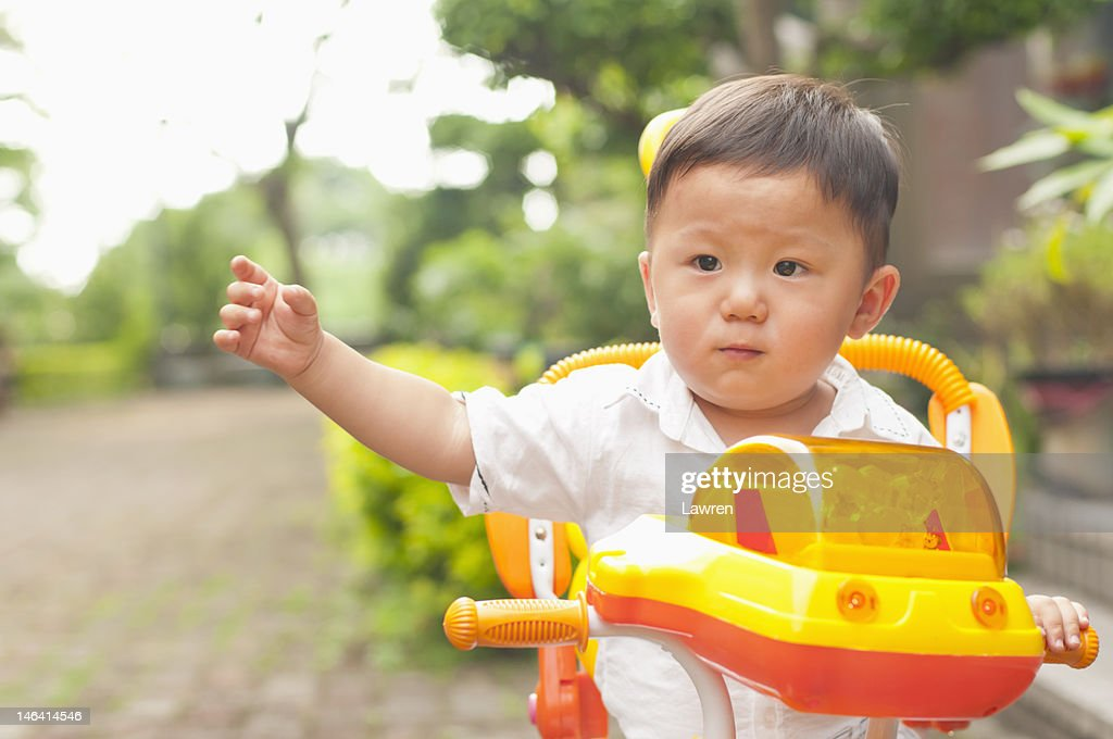 Little boy riding bicycle : Stock Photo