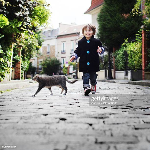 Little boy running in a cobbled narrow street