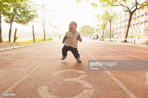 Little boy running in playground