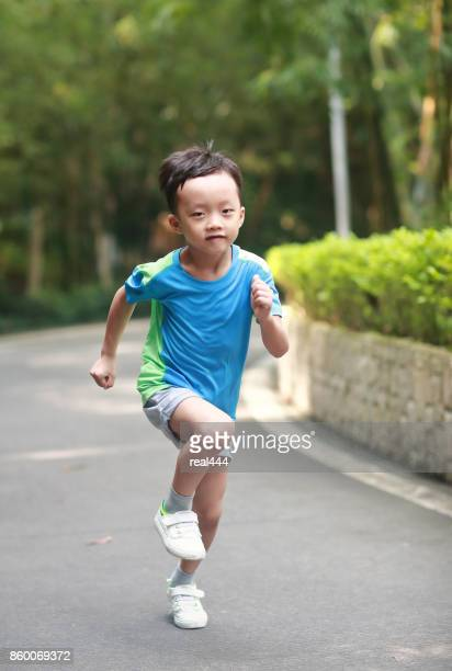 Little boy running in the park