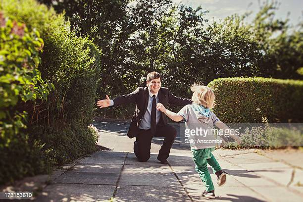 Little boy running to hug his father