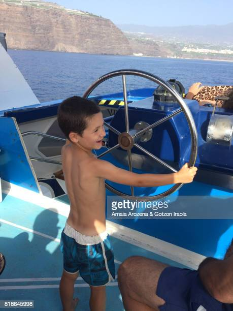 Little boy sailing on a yacht
