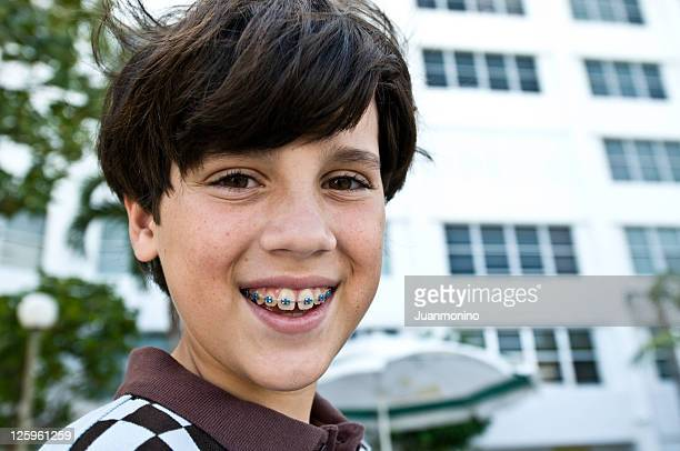 Little boy showing his braces
