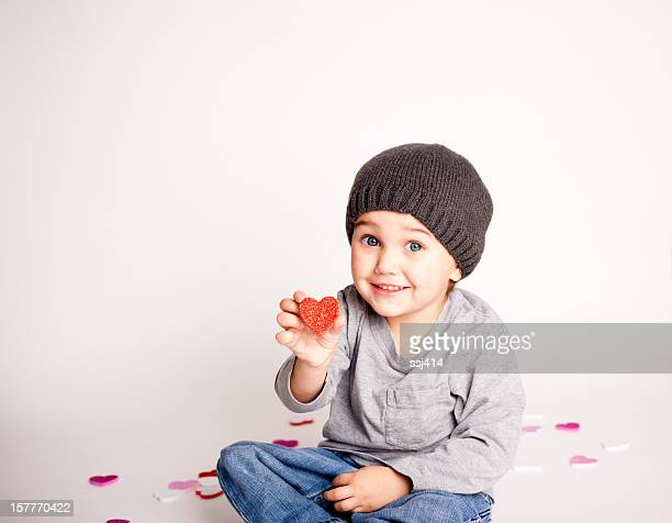 Little Boy Showing Red Heart Smiling at Camera
