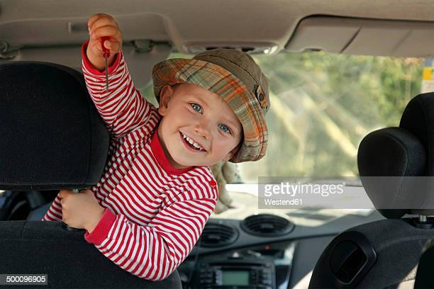 Little boy showing screw driver in the car