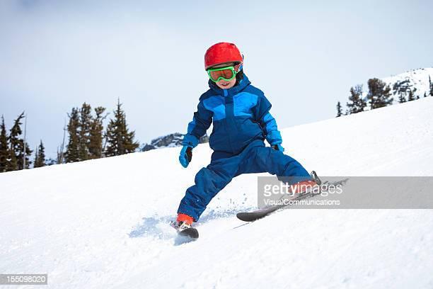 little boy skiing.