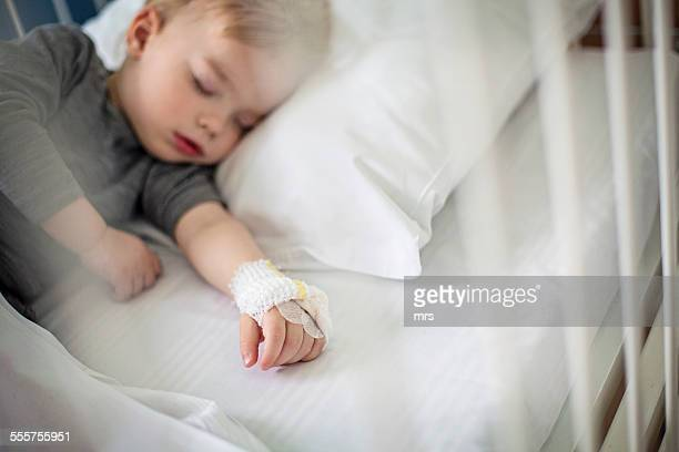 Little boy sleeping in hospital