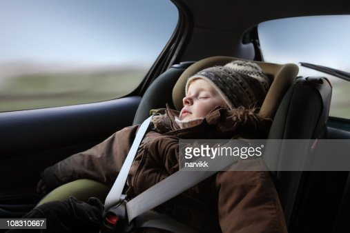 Little Boy Sleeping in the Child Seat