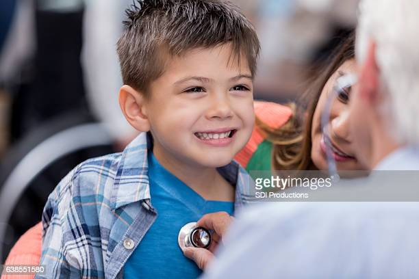 Little boy smiles during well check