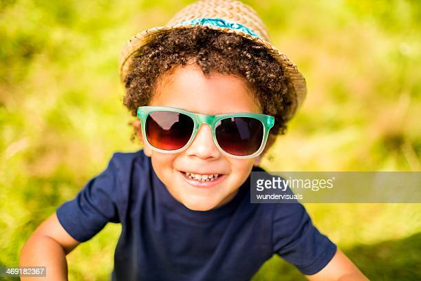 Little boy smiling at camera in park