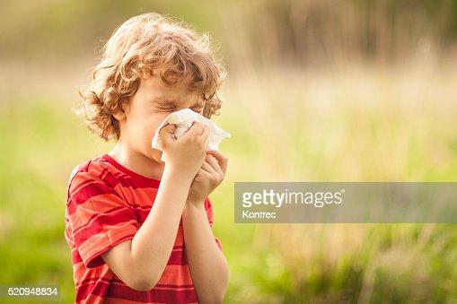 Little boy sneezing