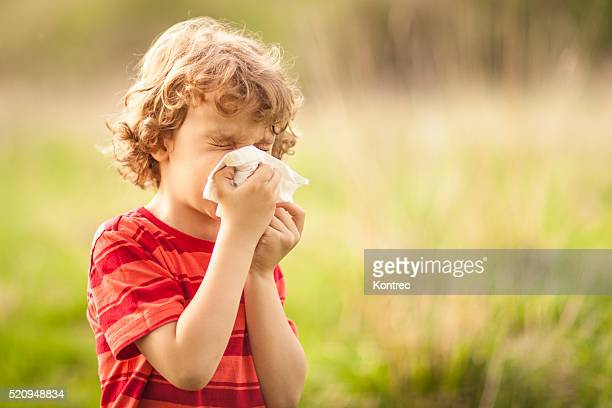Little boy sneezing