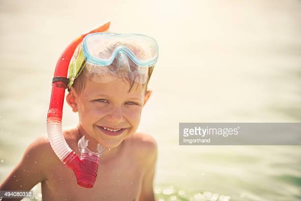 Little boy snorkeling