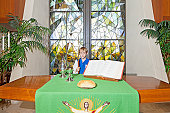 Little boy standing by the altar table