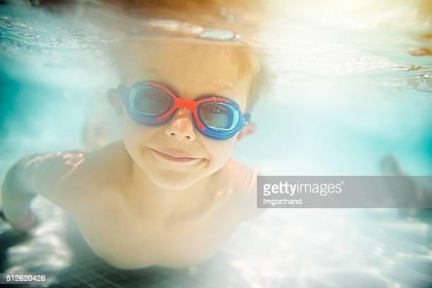 Little boy swimming underwater