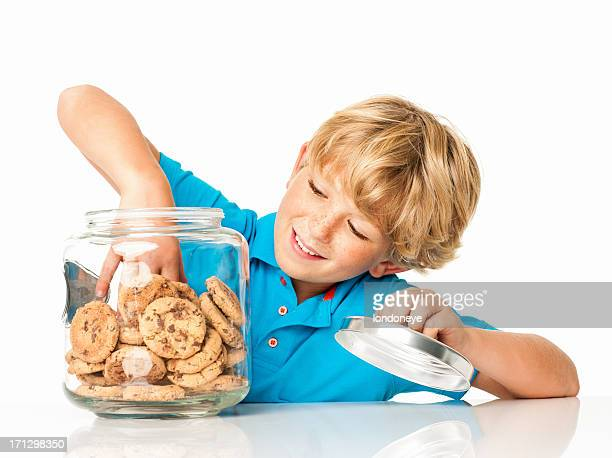 Little Boy Taking Out Chocolate Chip Cookie - Isolated