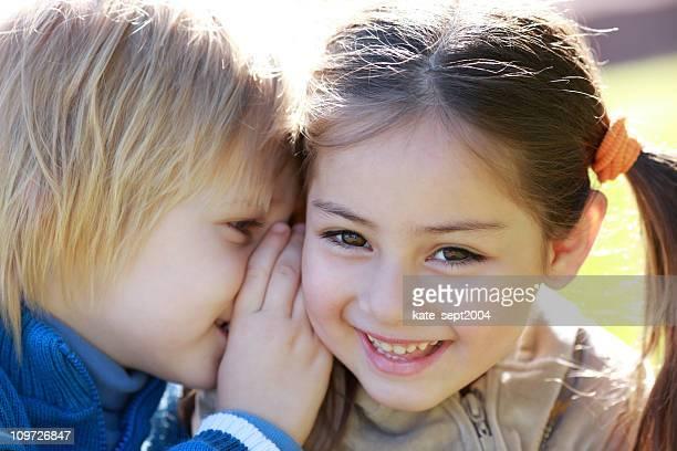 Little Boy Telling Girl Secret