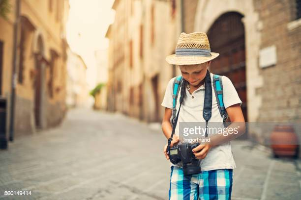 Little boy tourist sightseeing italian city of Piombino