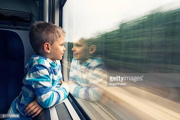 Little boy travelling on train