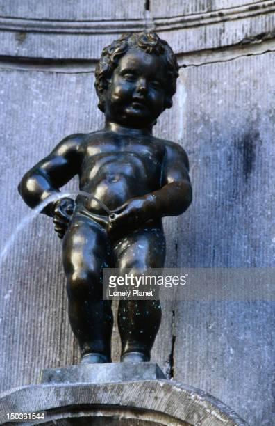 Little boy urinating statue at Manneken Pis monument.