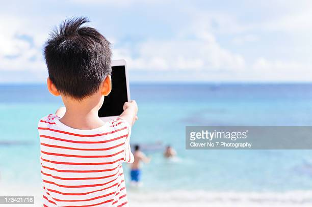 Little boy using a digital tablet.