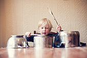 Little boy using saucepans as drums