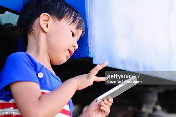 Little boy using smart phone.