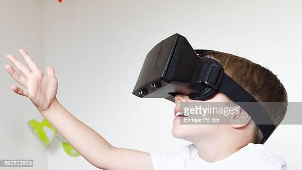 Little boy using VR headset