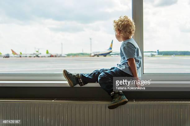 Little boy waiting for a flight