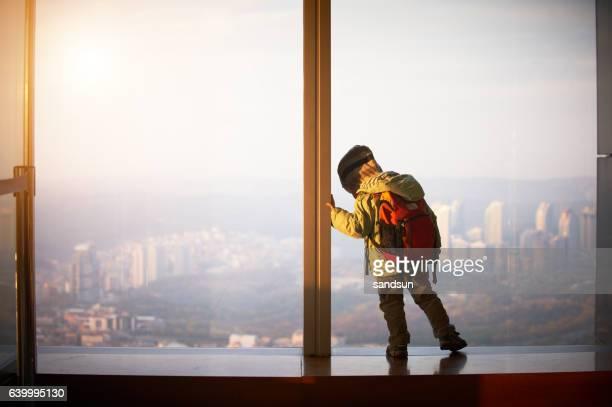 little boy walking on a observation deck