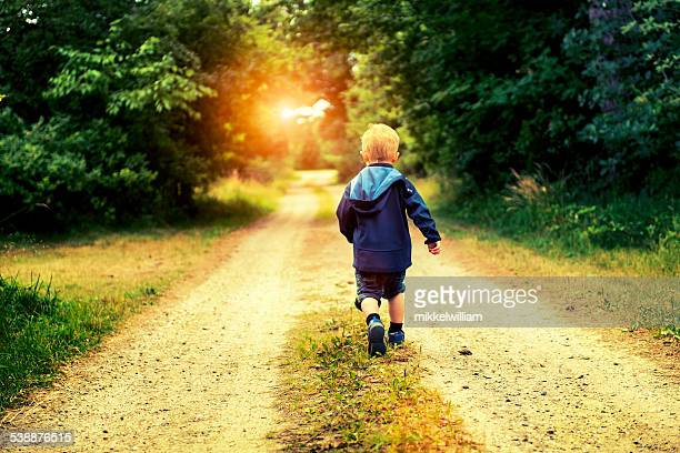 boy walking alone on road - photo #13