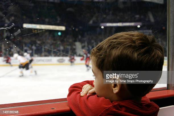 Little boy watching hockey game