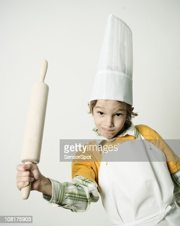 Little Boy Wearing Chefs Hat and Holding Rolling Pin : Stock Photo