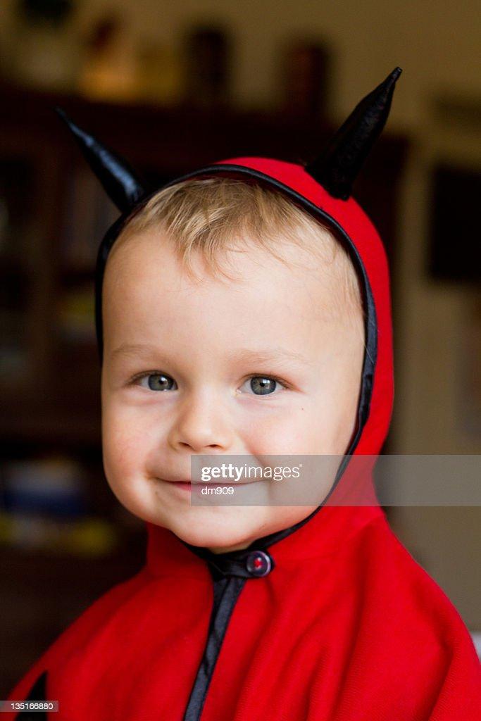 Little boy wearing devil costume : Stock Photo