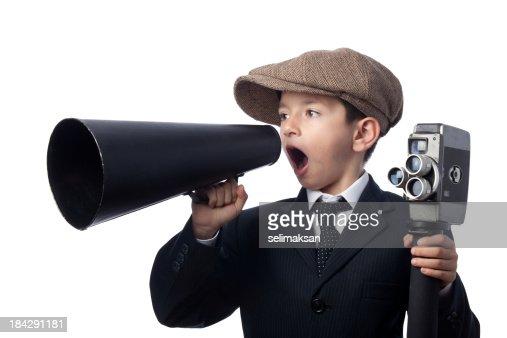 Little boy wearing newsboy cap,, holding camera, Shouting With Megaphone