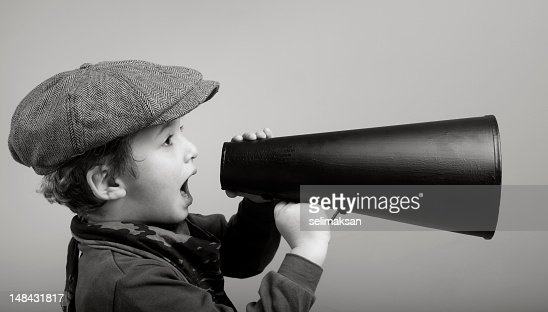 Little Boy Wearing Newsboy Cap Shouting On Old Fashioned Megaphone