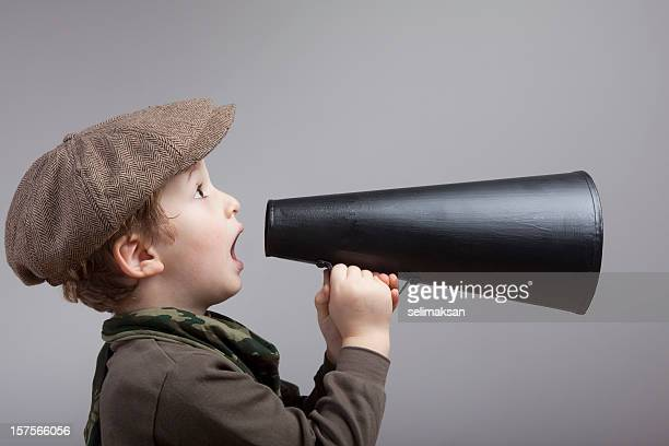 Little Boy Wearing Newsboy Cap Shouting On Old Fashioned Megaphone