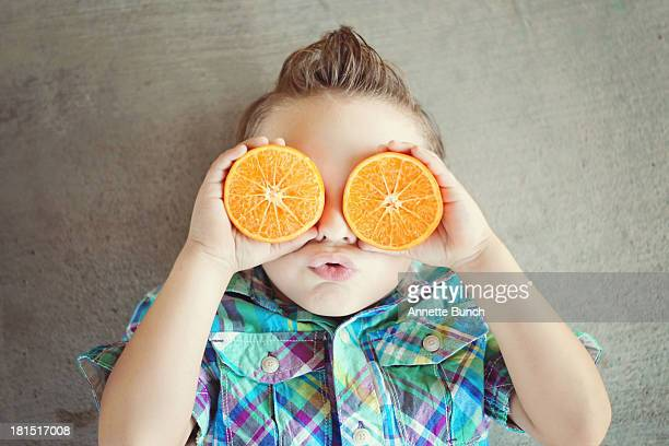 Little boy wearing orange goggles