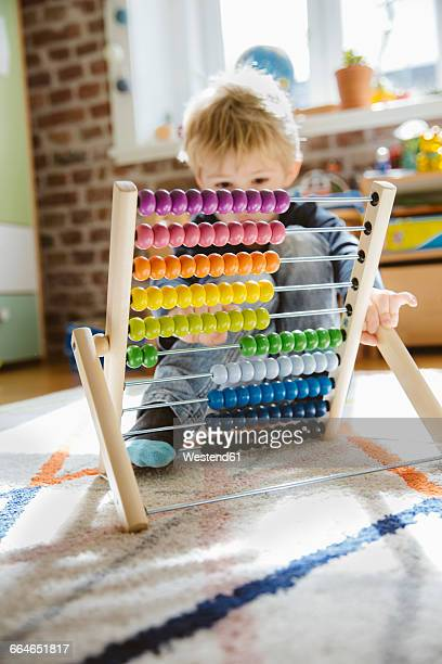 Little boy with abacus