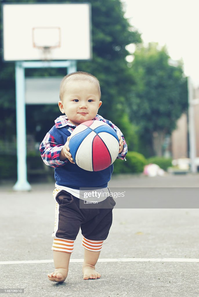 Little boy with basketball : Stock Photo