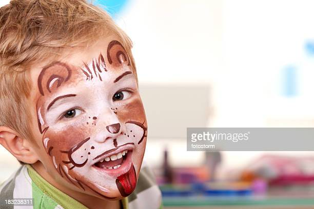 Little boy with face painted on birthday party