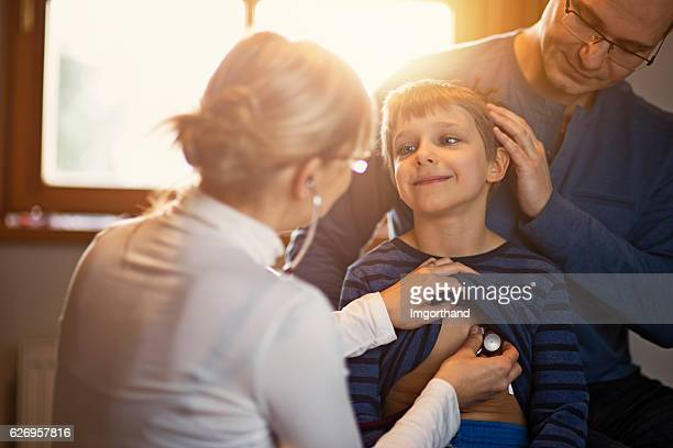 Little boy with father having medical examination