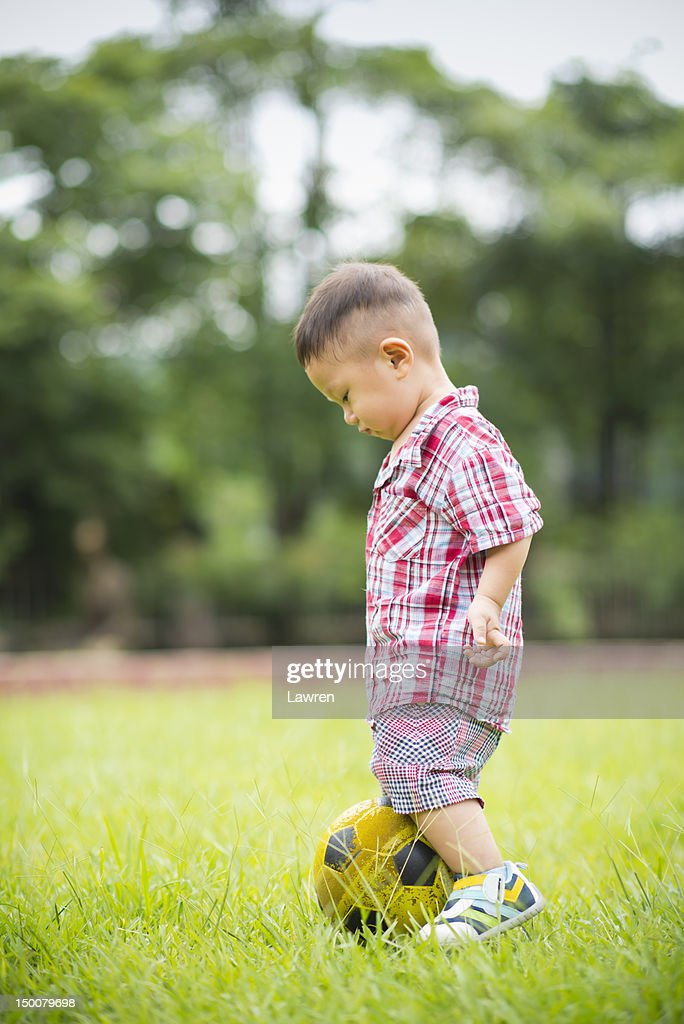 Little boy with football : Stock Photo