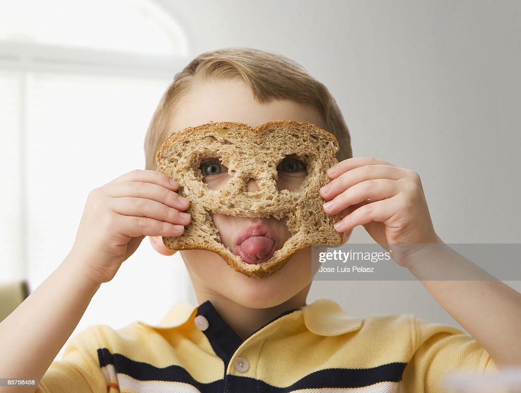 Little boy with happy face bread : Stock Photo