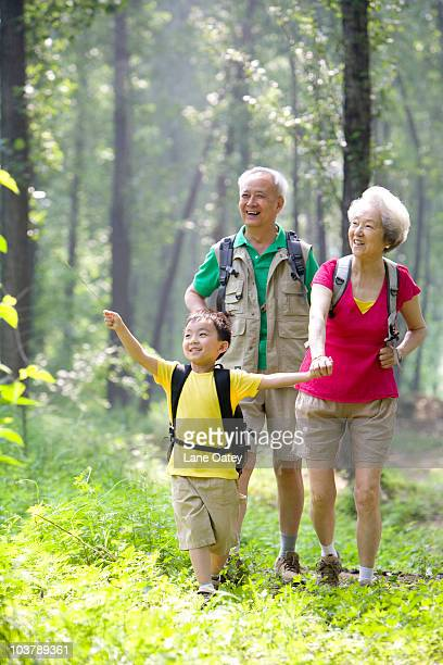 Little boy with his grandparents hiking