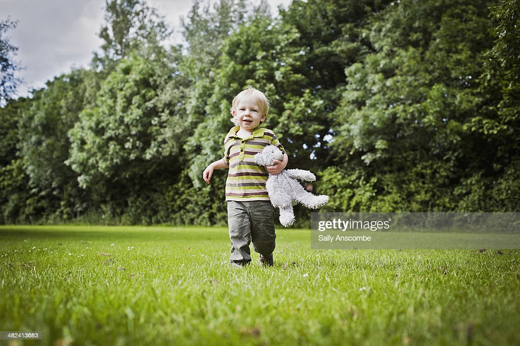 Little boy with his teddy bear : Stock Photo