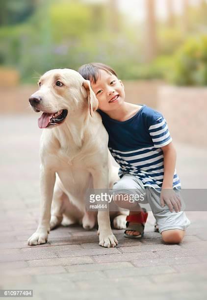 Little boy with Labrador retriever